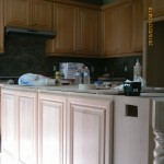 Cabinets before stained darker