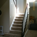 Spindles painted white handrails stained dark