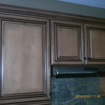 Cabinets lacquered darker and antiqued
