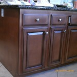 Kitchen cabinets painted darker and antiqued