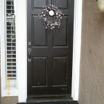 front door painted black and distressed