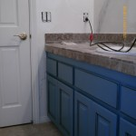 Oak cabinets painted blue