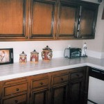 oak cabinets with black antique after