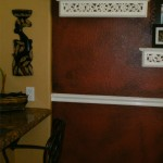 black antiquing on wall with chair rail